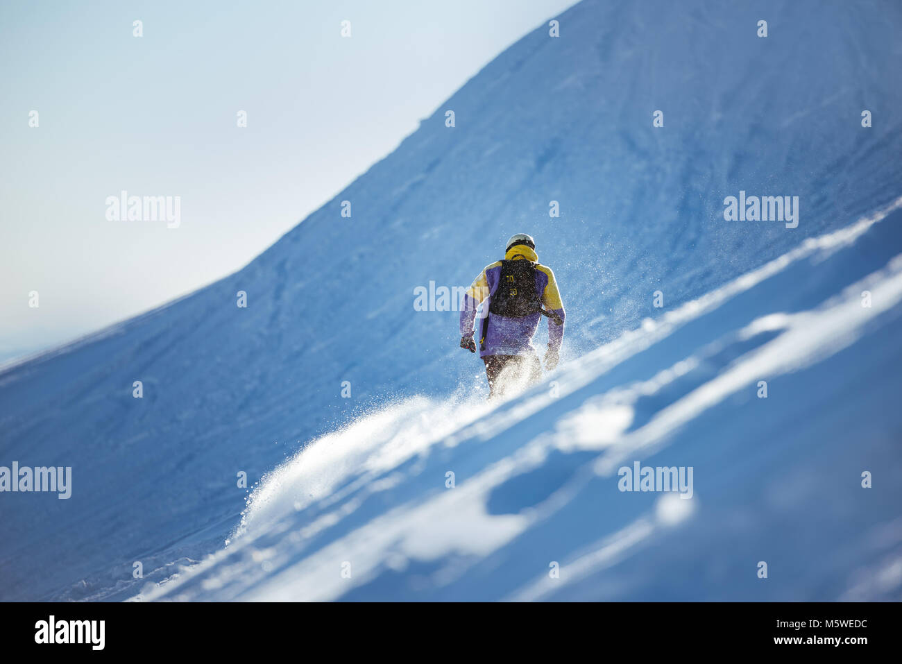 Snowboarding concept with offpiste backcountry snowboarder or skier - Stock Image