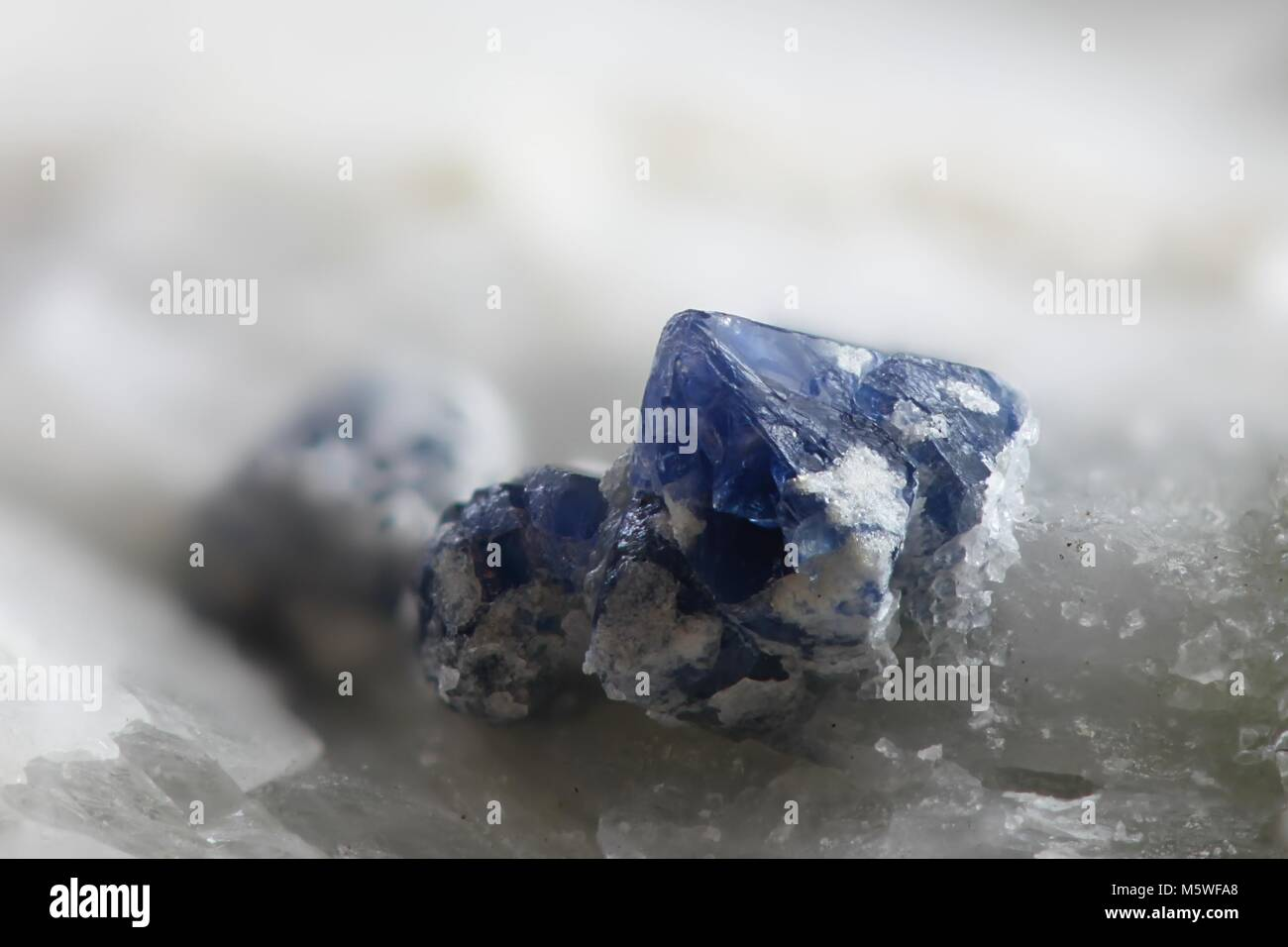 Blue spinel crystals in calcite matrix from Mustio marble quarry in