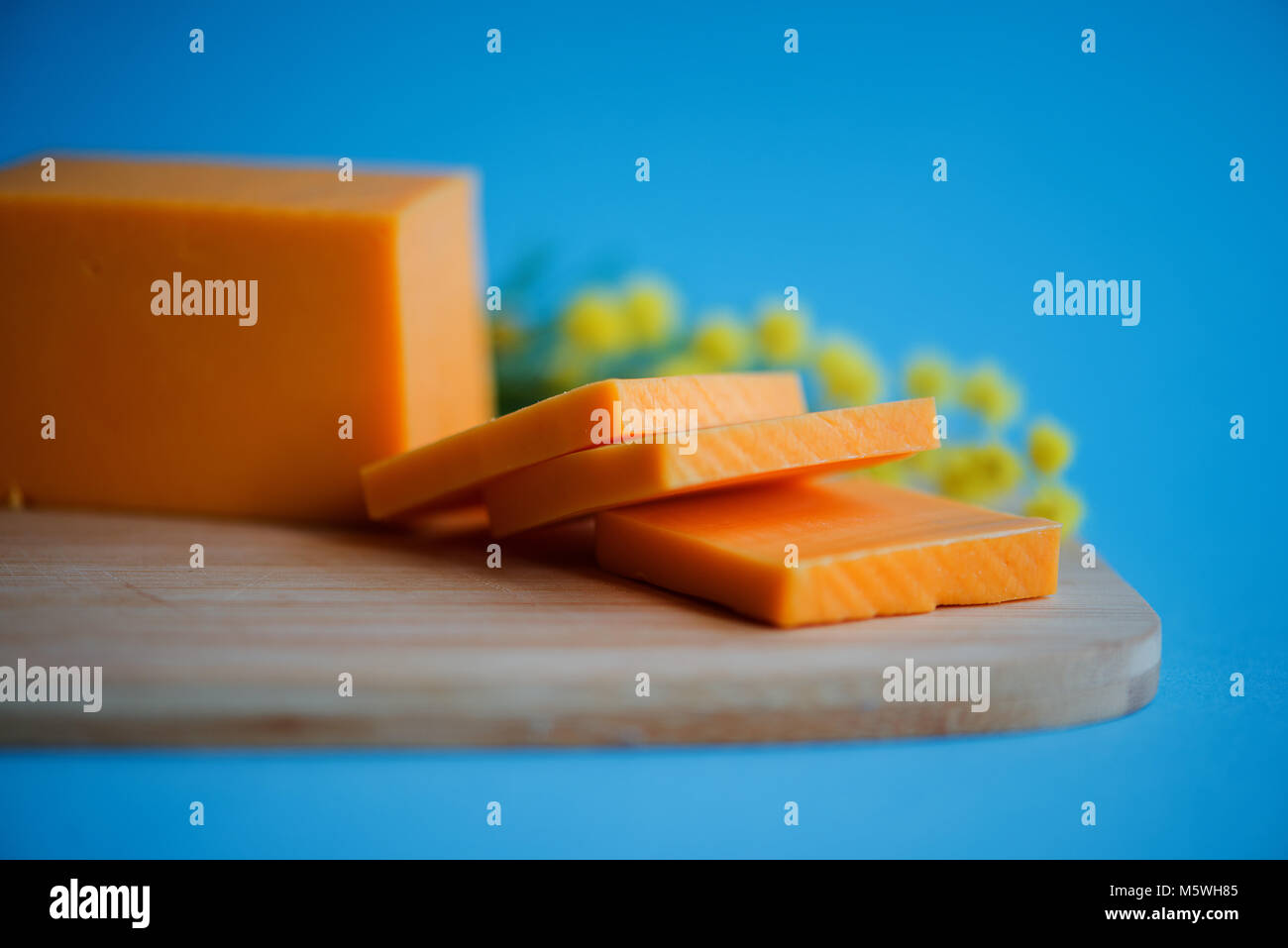 Mix cheese on wooden cutting board.Top view. - Stock Image