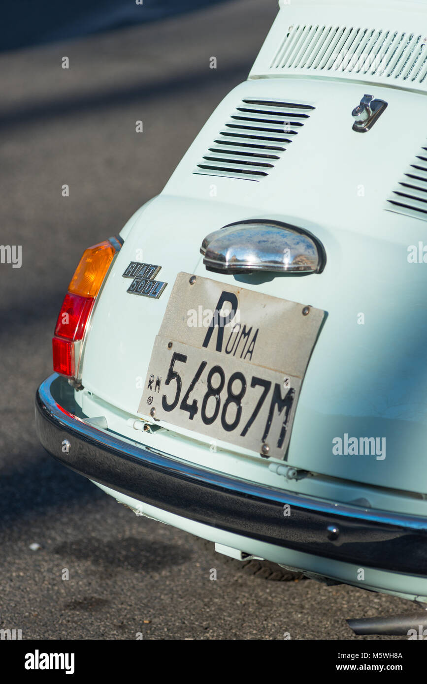 A Classic Fiat 500 with Roma number plates in Rome city street. Lazio, Italy. - Stock Image