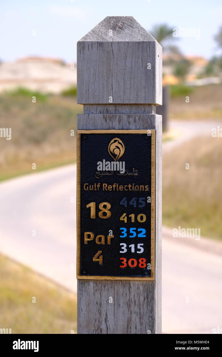 Golf Course Layout Stats engraved on wooden pole- Saadiyat Island Golf Course - Stock Image