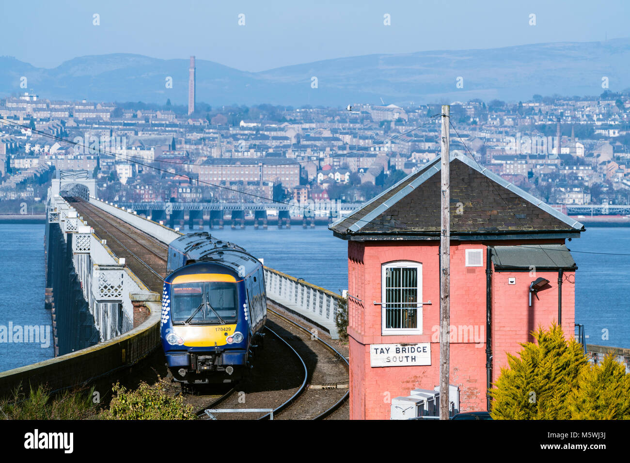 View of Scotrail diesel passenger train travelling towards Dundee across the Tay Rail Bridge at Wormit in Tayside, - Stock Image