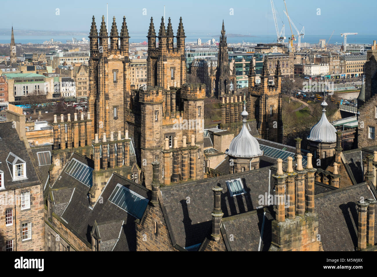 View over spires and towers of New College , part of Edinburgh University , on The Mound in  Edinburgh, Scotland, - Stock Image