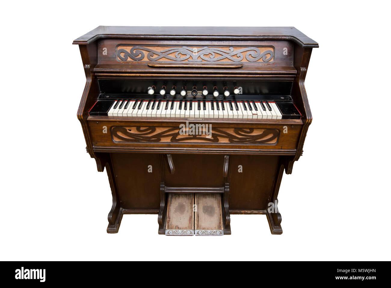 Harmonium. Pump organ, isolated on white. Status old - Stock Image