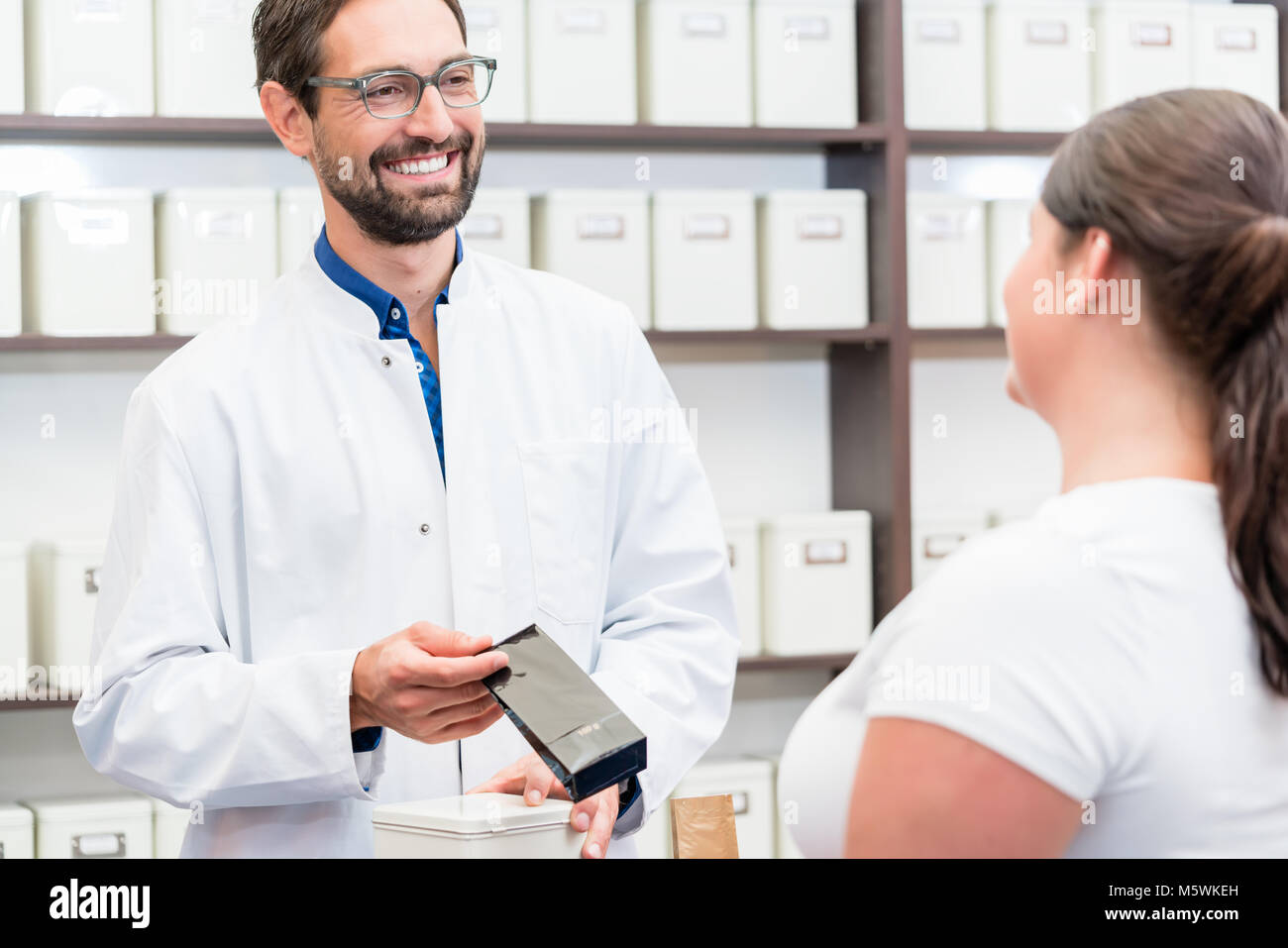 Woman shopping alternative drugs at herbalist Stock Photo