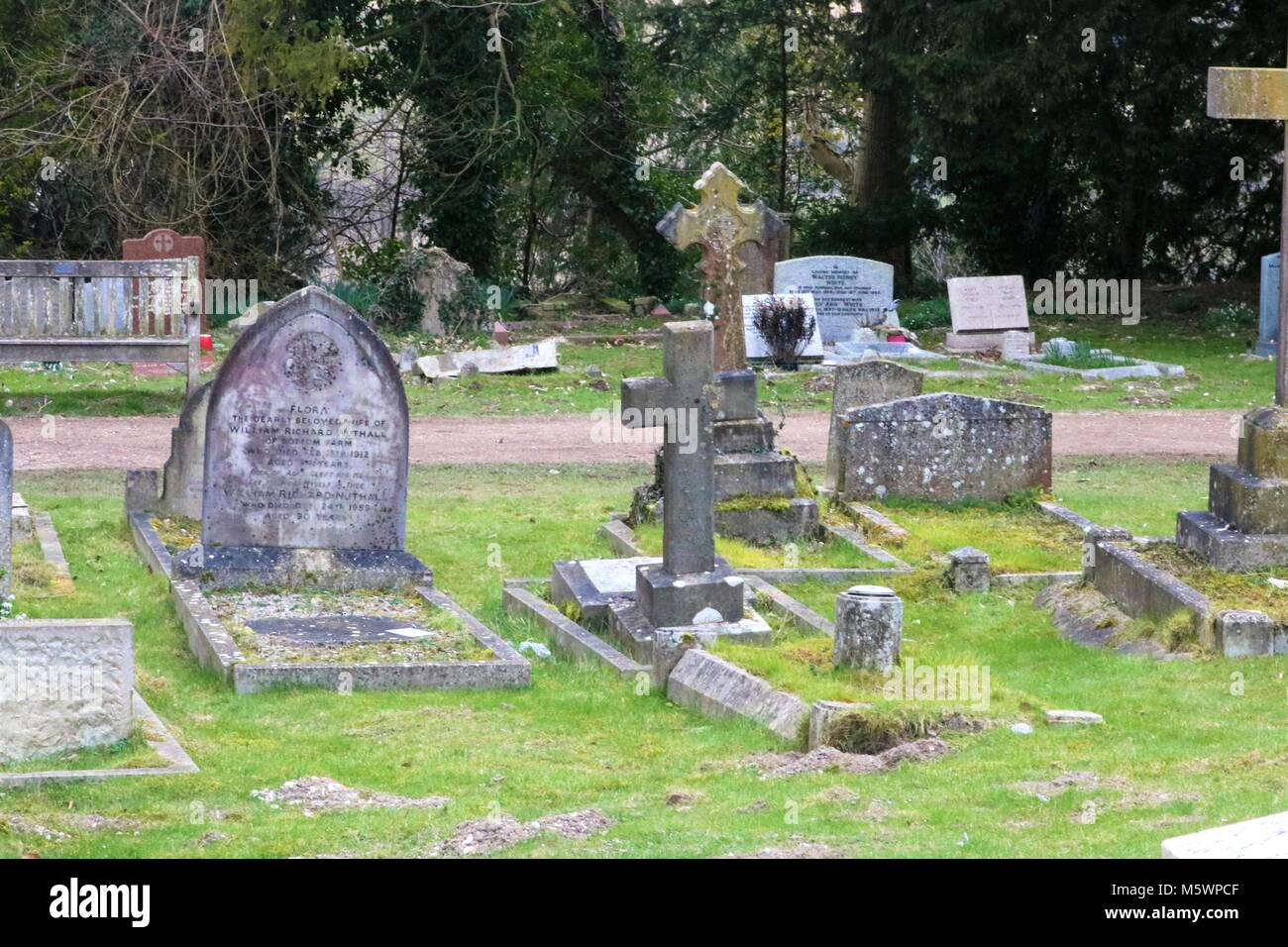 Headstone in graveyard at St Lawrence Church, West Wycombe, UK - Stock Image