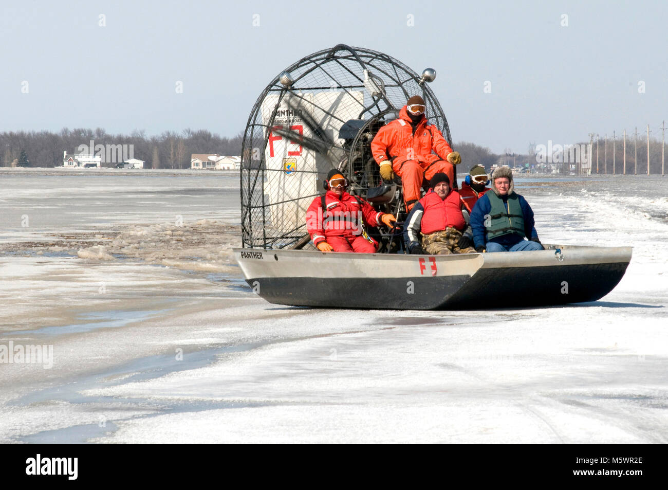 The Red River Valley Water Rescue team brings in a home owner who needed to be resuced from the rising waters of - Stock Image