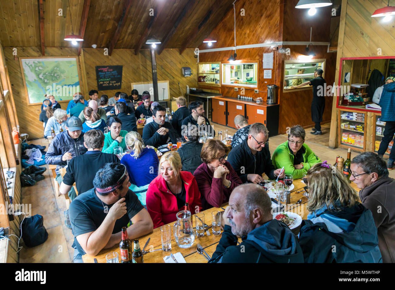 Trekkers dining at Refugio El Chileno; Torres del Paine National Park; Chile - Stock Image