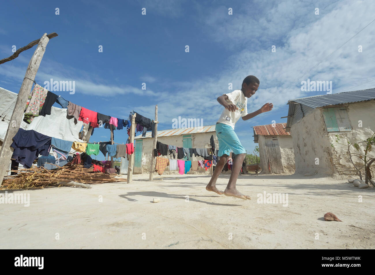 A boy plays hopscotch in the Haitian community of Ganthier. - Stock Image