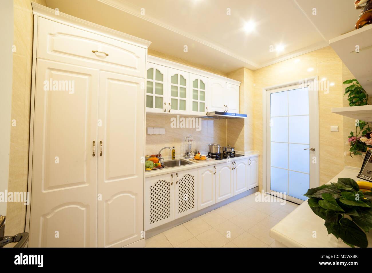 The Kitchen, White Furniture, China Housing Units   Stock Image