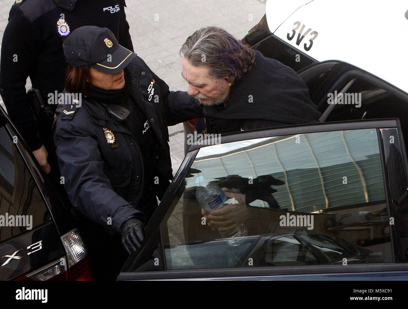 Handcuffed alleged drug trafficker Jose Ramon Prado Bugallo aka Sito Minanco arrives to testify to a court in Pontevedra, - Stock Image