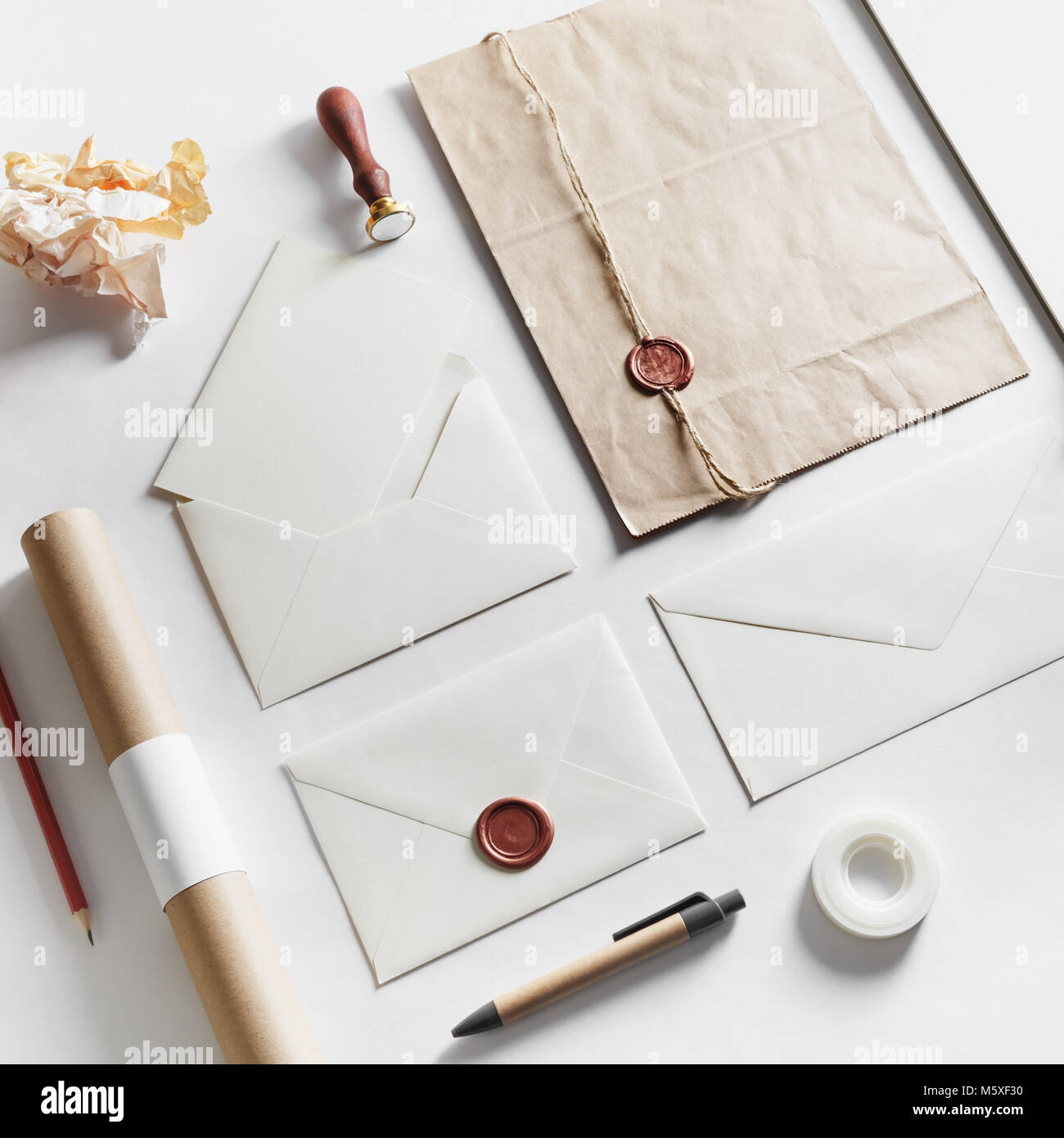 Vintage still life with postal accessories. Blank stationery and envelopes on paper background. Responsive design mockup. Stock Photo