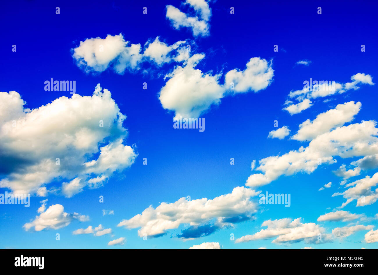 Skyscape with cumulus clouds in the blue sky - Stock Image