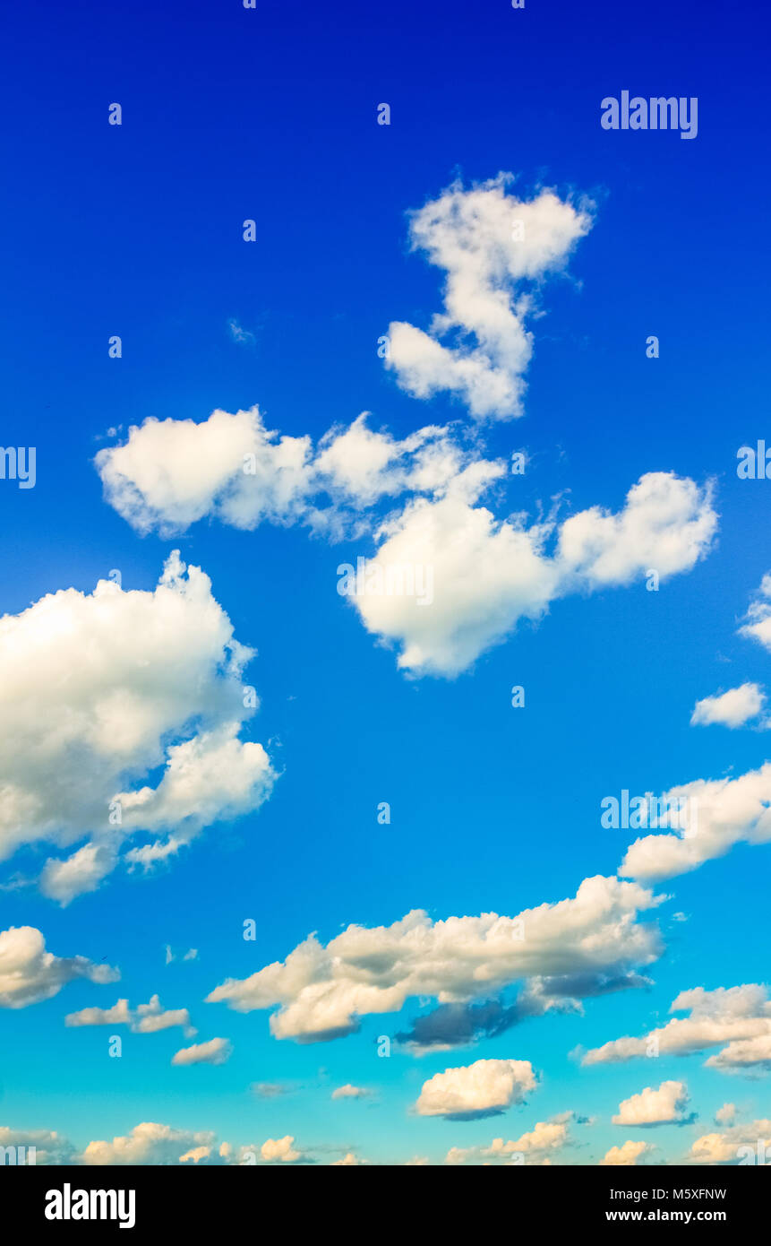 Summer cumulus clouds against a blue sky in the summer - Stock Image