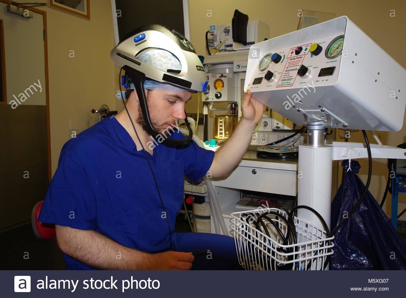 Medical Professional in the Operating Theatre of a Modern British Hospital. NHS Healthcare, Medical Science. Exeter, - Stock Image