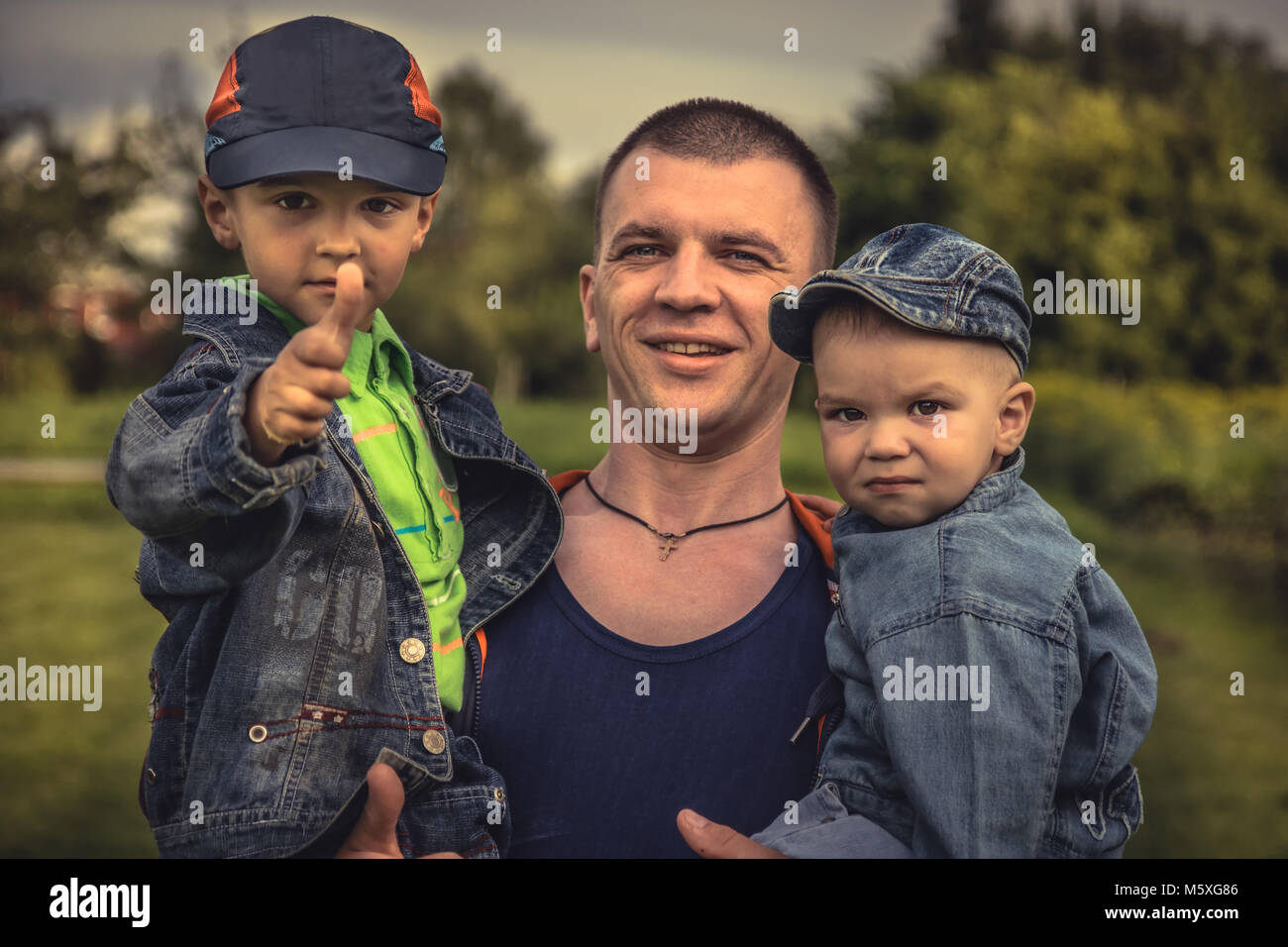 Masculine father sons family lifestyle portrait concept happy paternity - Stock Image