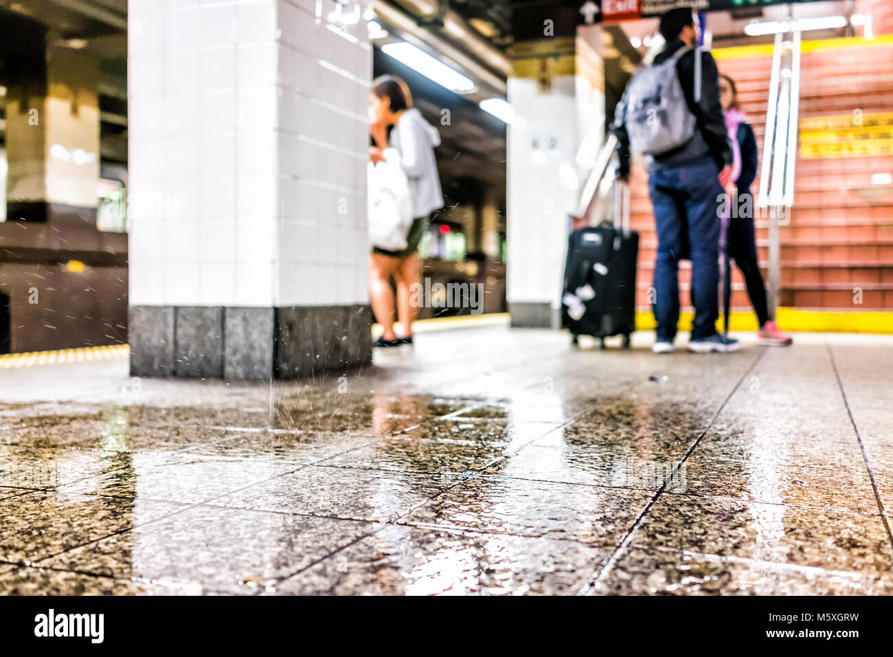 New York City, USA - October 29, 2017: People waiting in underground transit empty large platform in NYC Subway - Stock Image