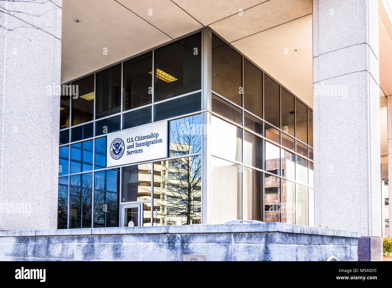 Fairfax, USA - January 26, 2018: USCIS US United States Citizenship and Immigration Services field main office entrance - Stock Image