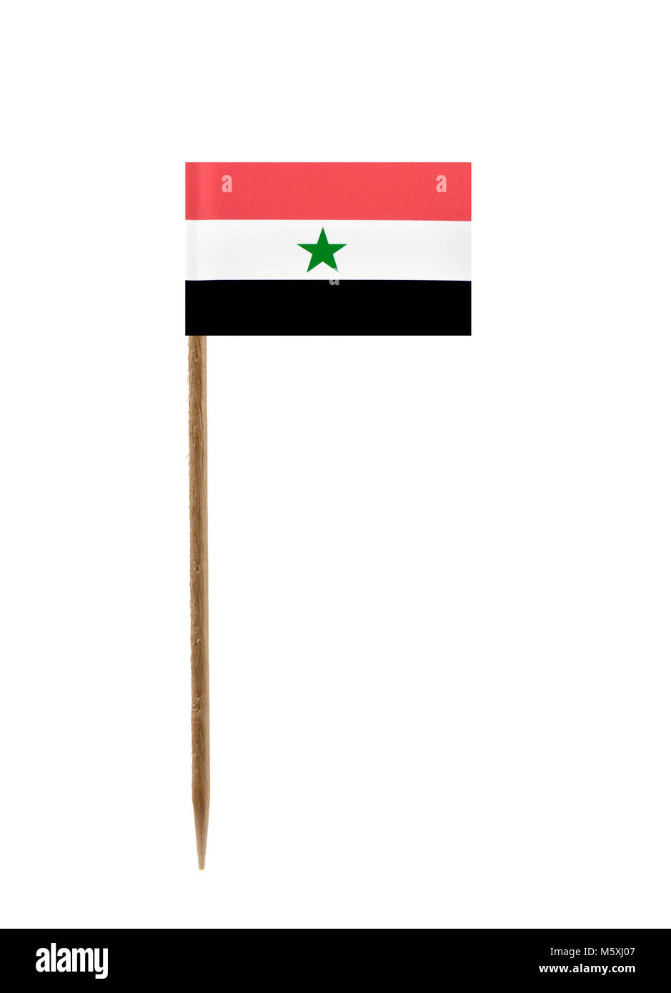 Tooth pick wit a small paper flag of Yemen - Stock Image