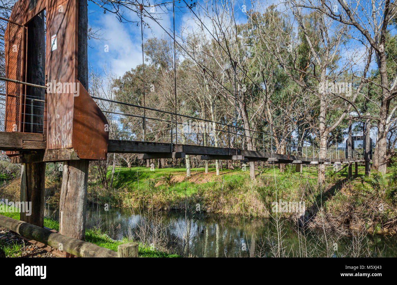 Australia, inland New South Wales, Wellington, suspension bridge over the Bell River in the Wellington parklands Stock Photo