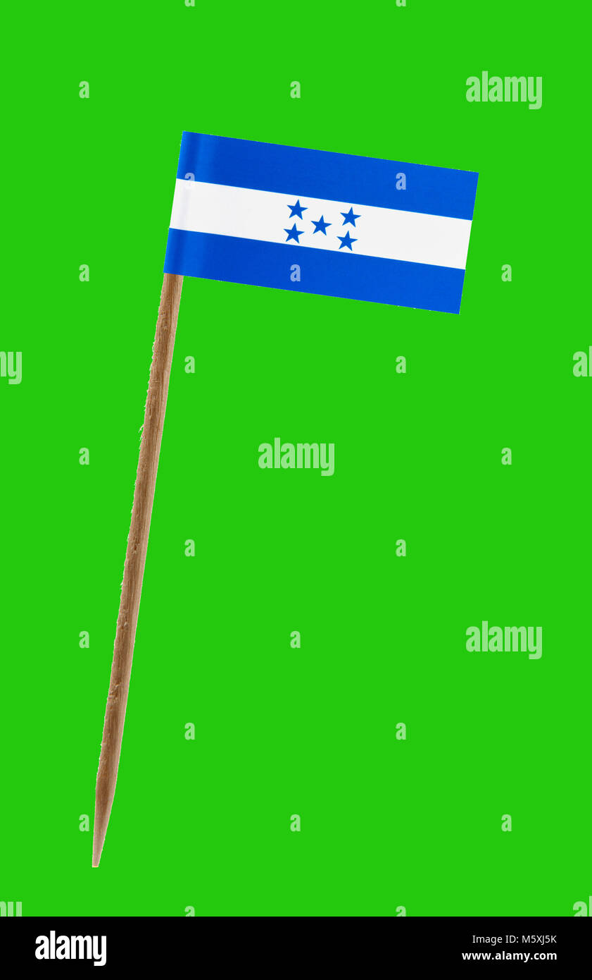 Tooth pick wit a small paper flag of Honduras on a green screen for chromakey Stock Photo