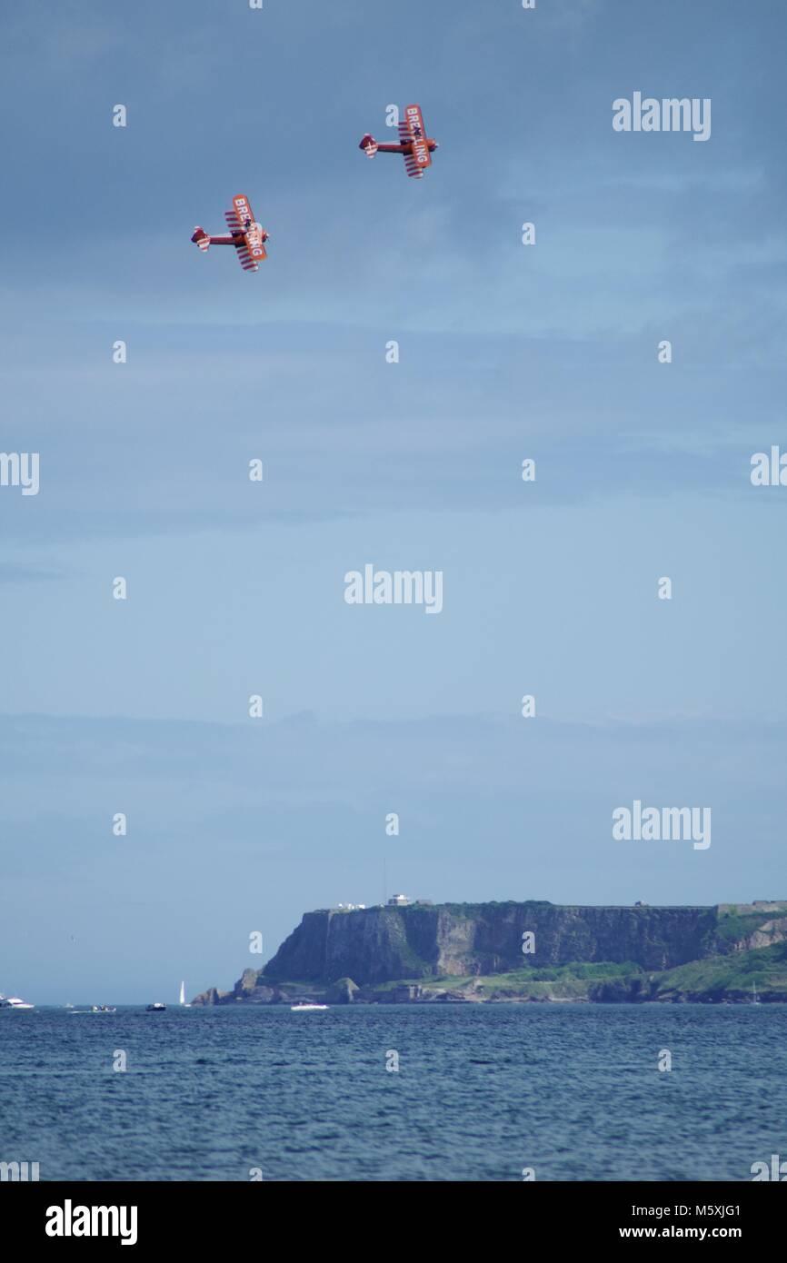 AeroSuperBatics Team, Breitling Wingwalker Bi-Plane. Pair of Orange Propeller Planes, Torbay Airshow, Summer, 2016. - Stock Image
