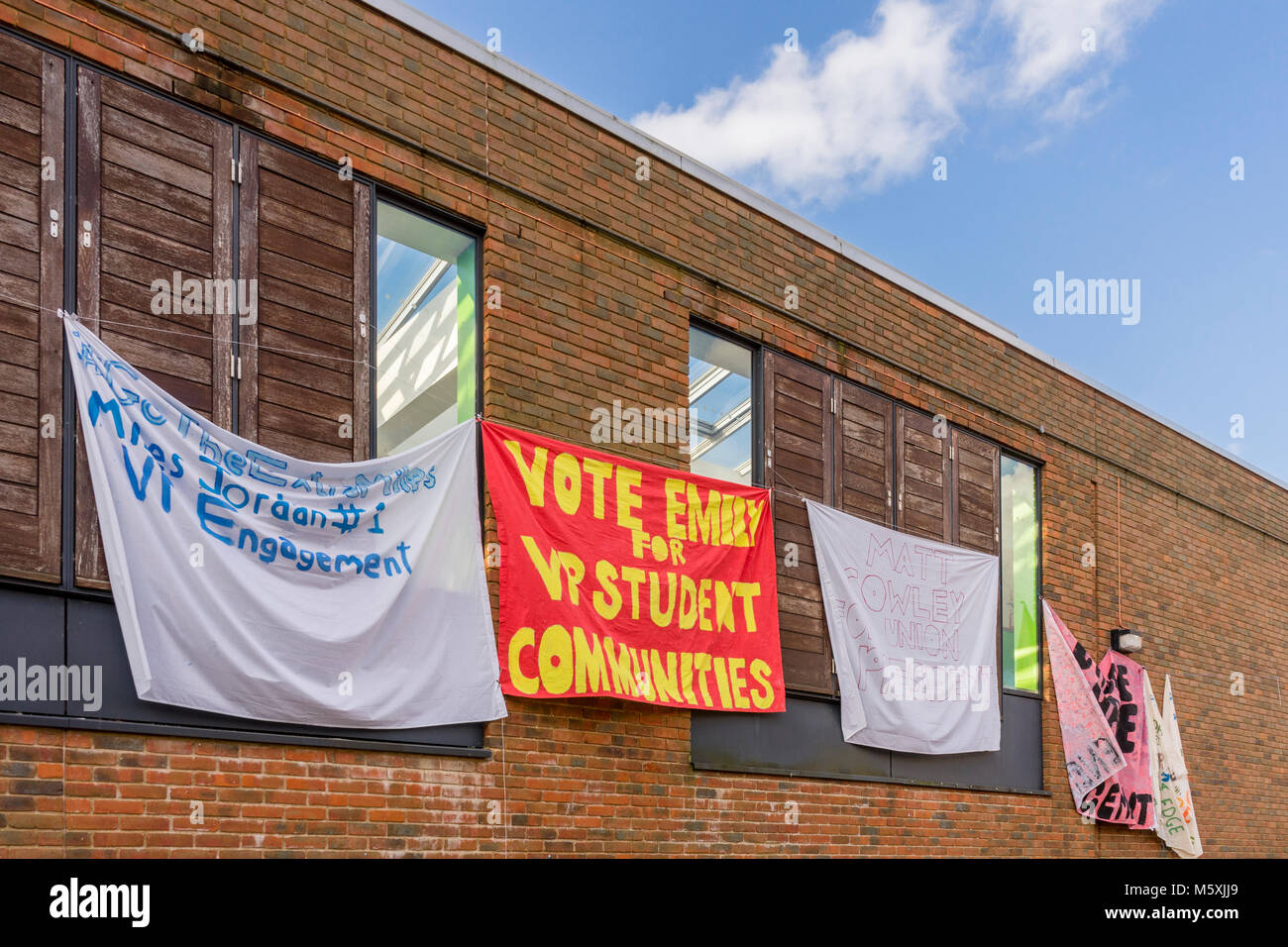 Banners hanging from a building during the SUSU presidential election campaign 2018 at Highfield Campus at the University - Stock Image