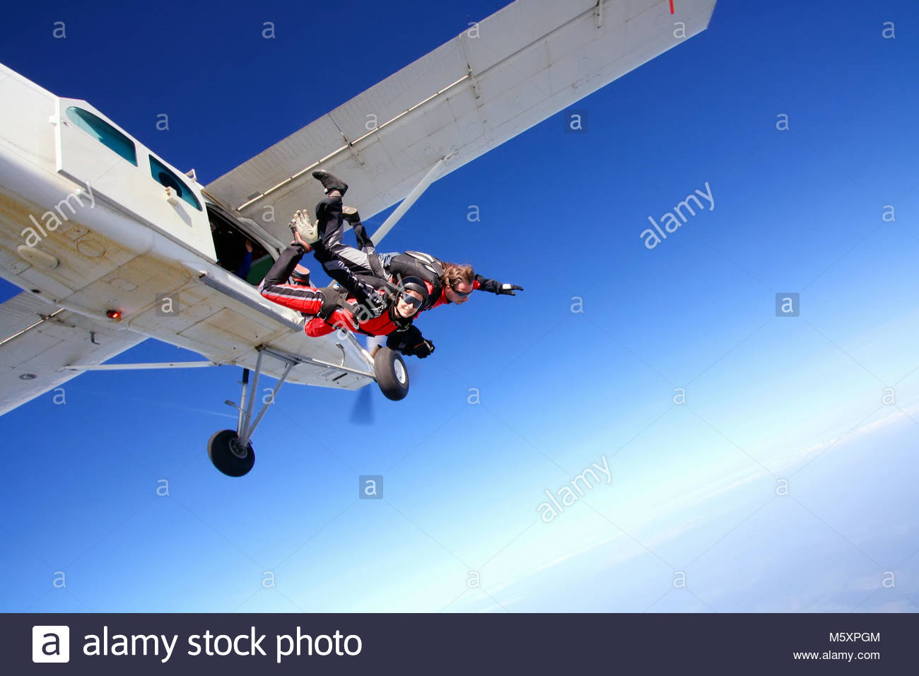 Skydive couple in action - Stock Image