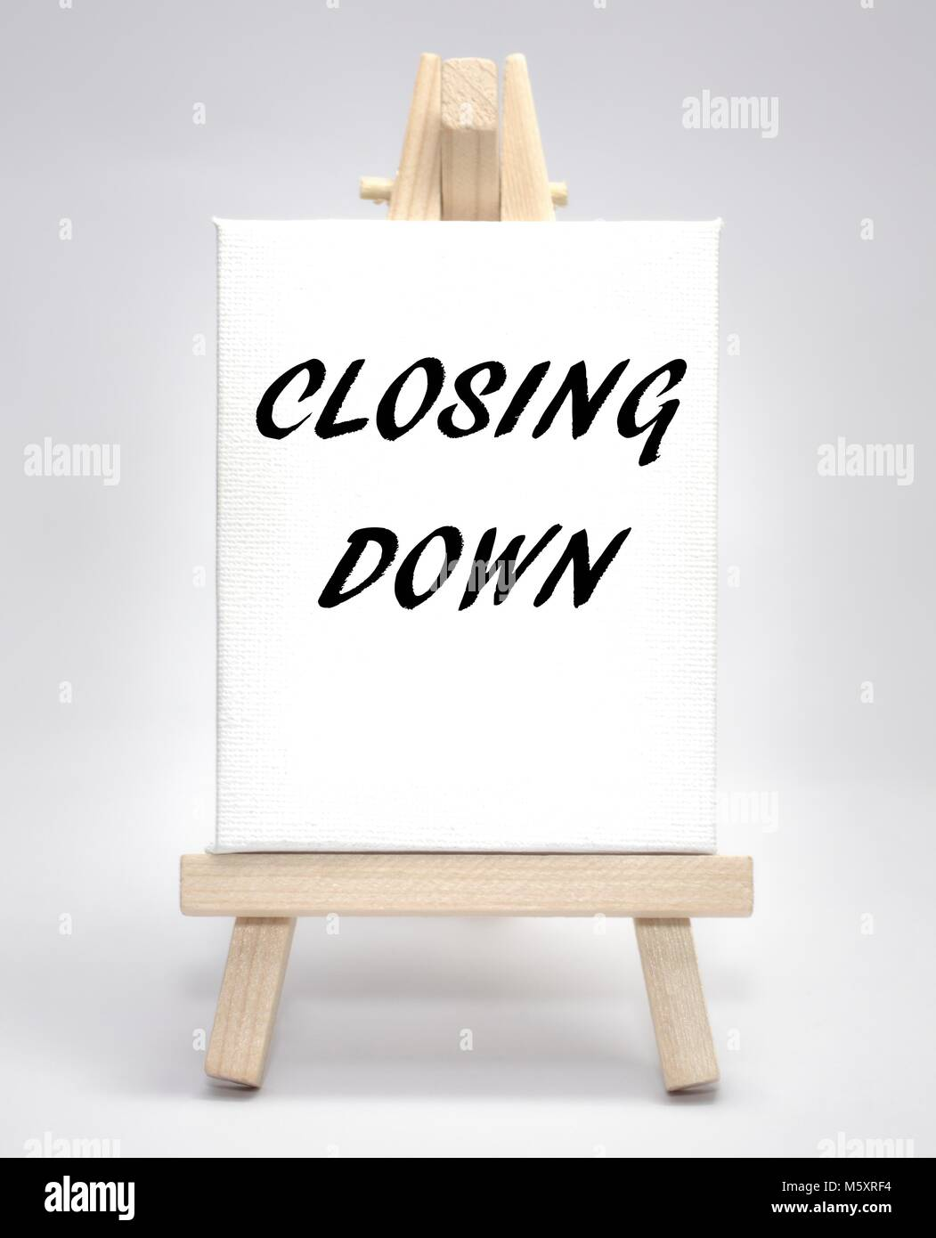 Closing down concept white canvas artist easel - Stock Image