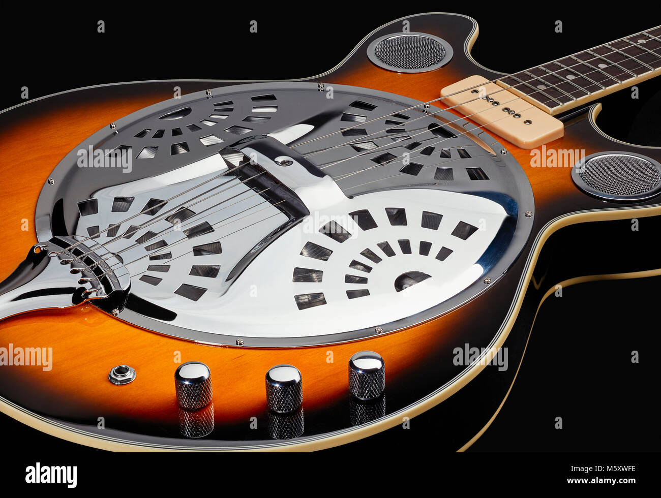 Eastwood Delta 4 tenor resonator guitar showing pick ups and controls - Stock Image
