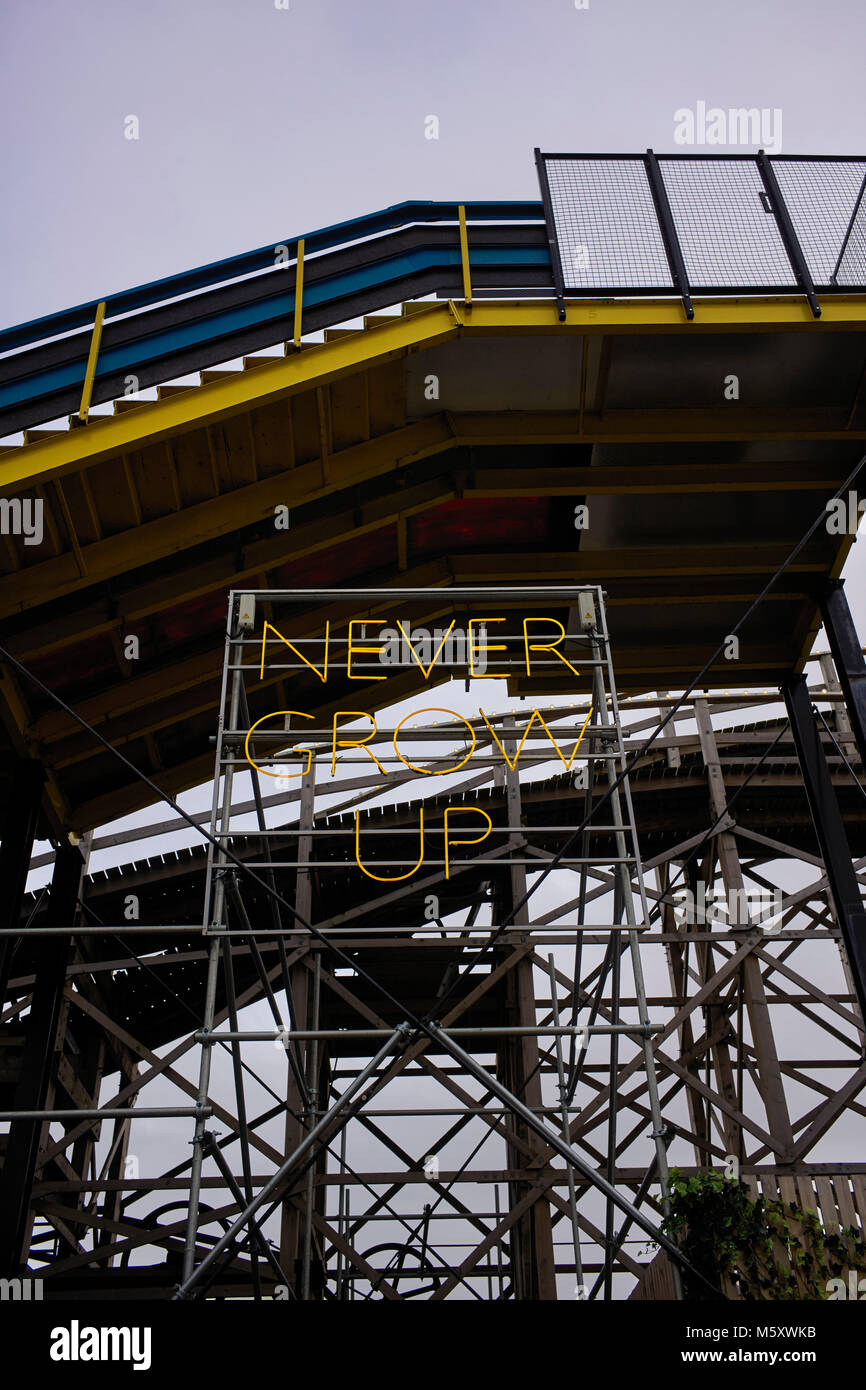 Never grow up neon sign at Dreamland fun fair in Margate - Stock Image