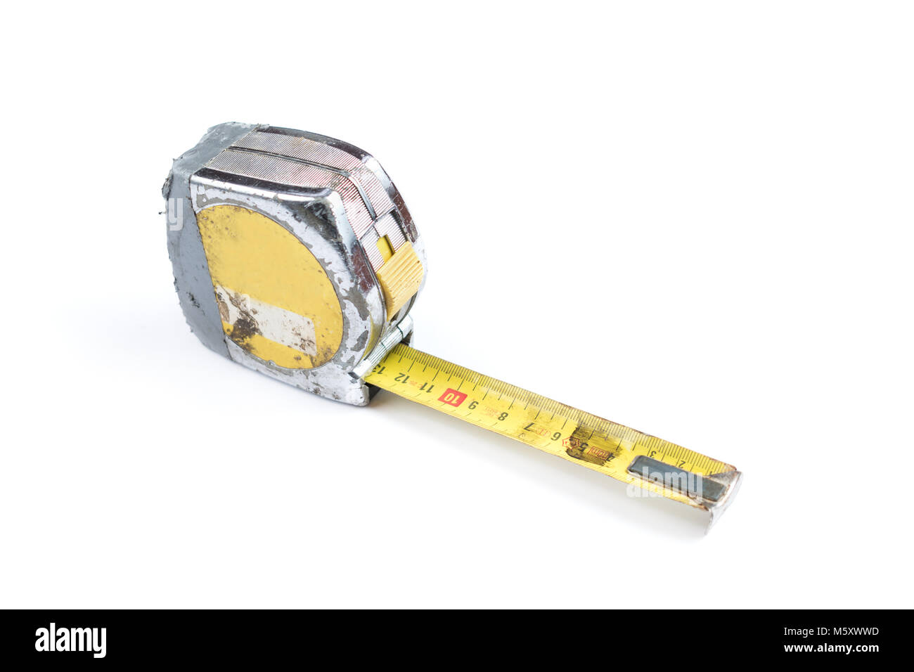 Old and worn out yellow measure tape on a white background, surface. Industrial measure tape. - Stock Image