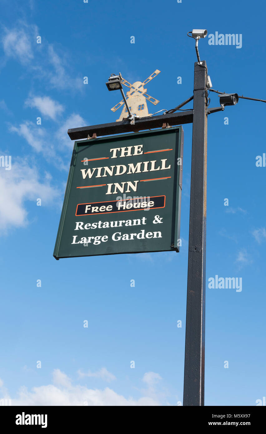 Hanging sign for The Windmill Inn free house (pub, public house) in Rustington, West Sussex, England, UK. British Stock Photo