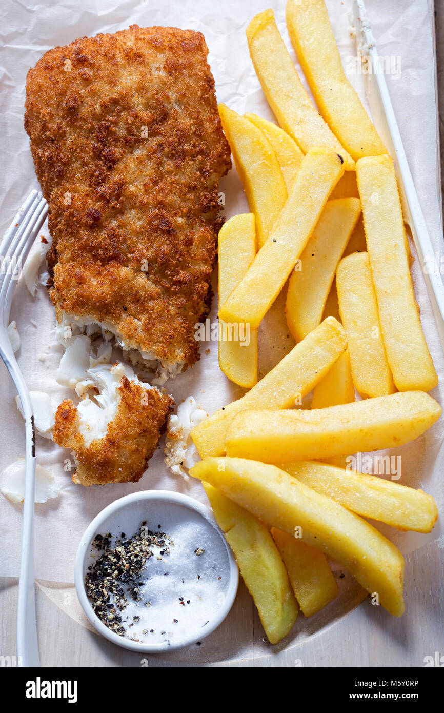 Breaded cod with chips. Fish and chips. - Stock Image