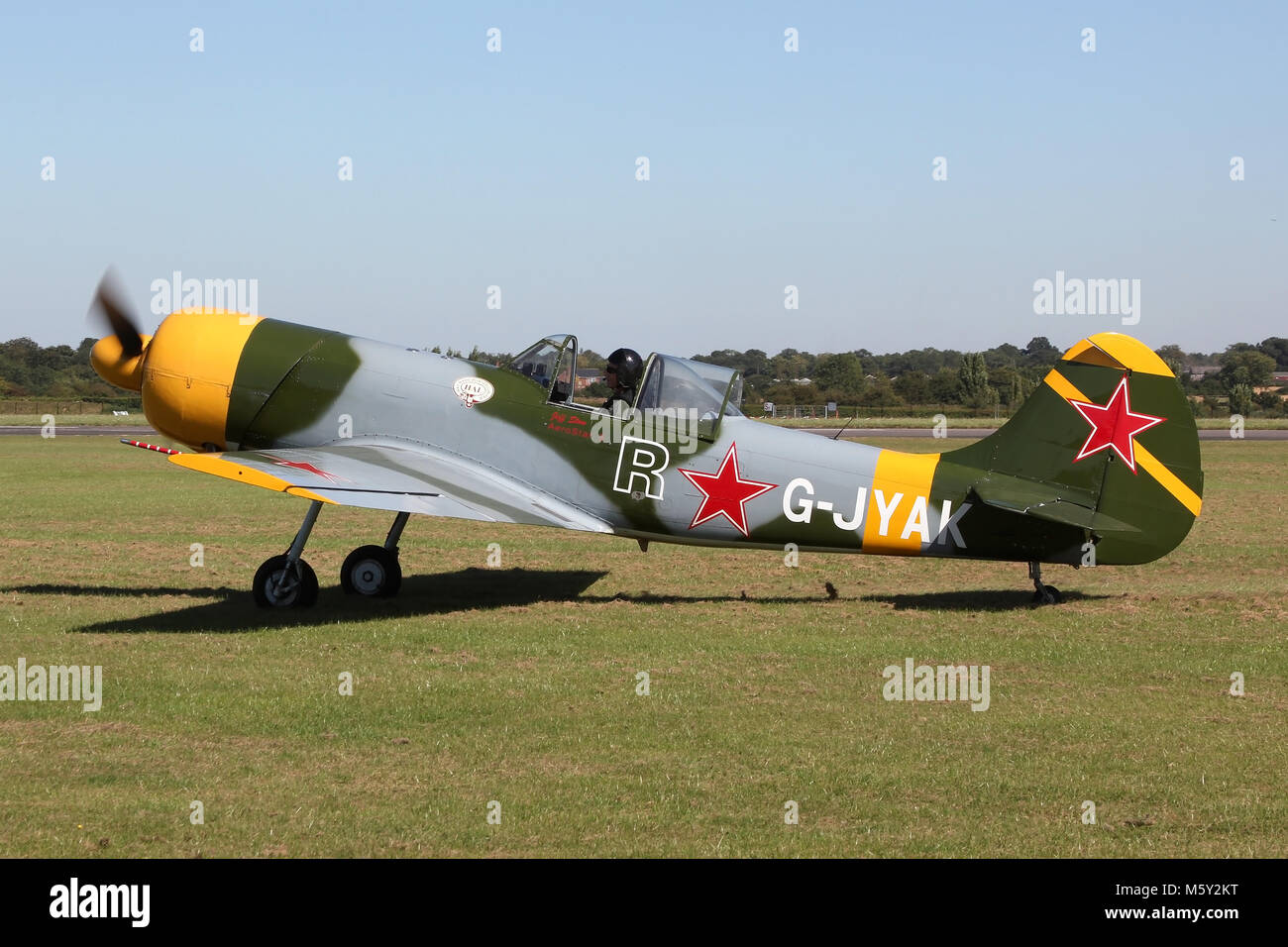 A privately owned Yakovlev Yak-50 taxiing out at the small airport of North Weald in Essex, UK. This aircraft is - Stock Image