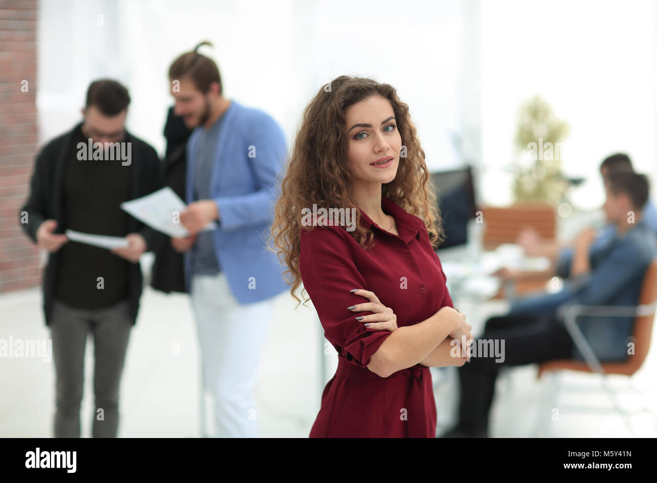 fashion designer standing in a creative Studio.p - Stock Image