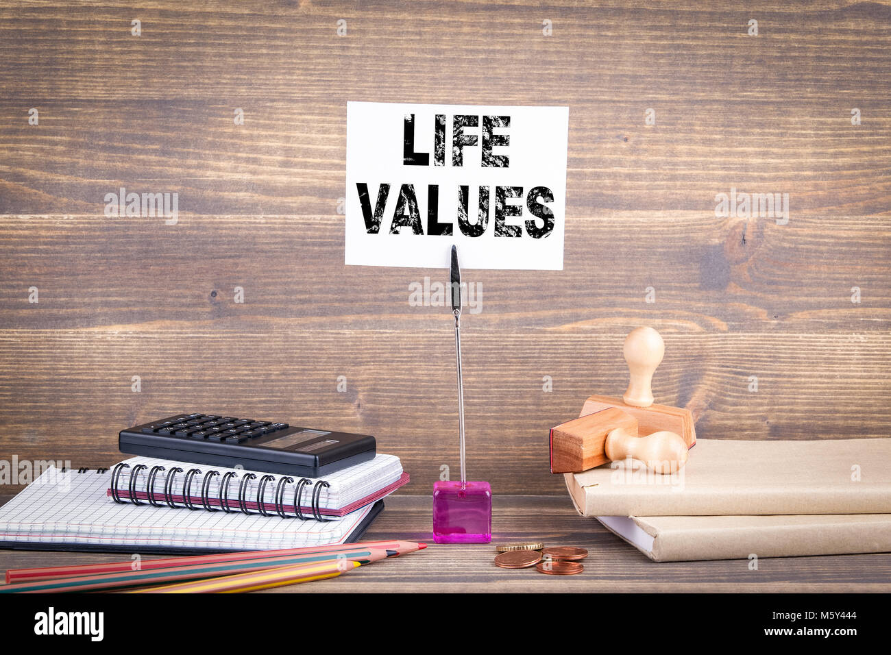 life values. Wooden table with stationery - Stock Image