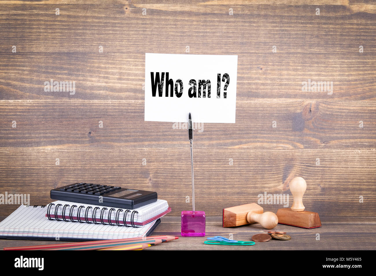 Who am I. Wooden table with stationery - Stock Image