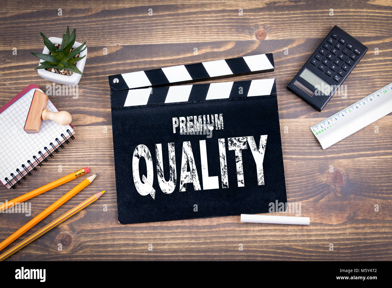 Premium Quality. Movie clapper on a wooden desk - Stock Image