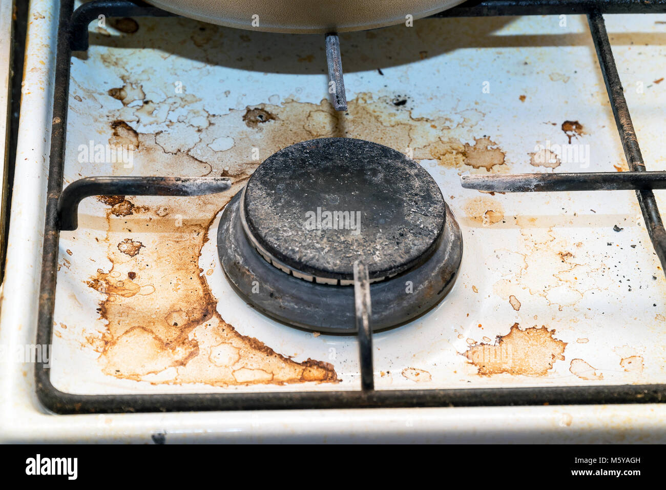 Dirty burner gas stove in the kitchen Stock Photo