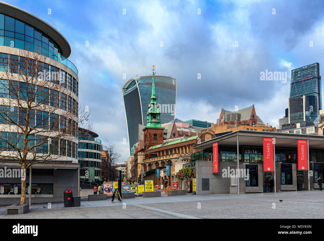 View of modern office buildings and All Hallows by the Tower - famous ancient Anglican church in London, UK. - Stock Image