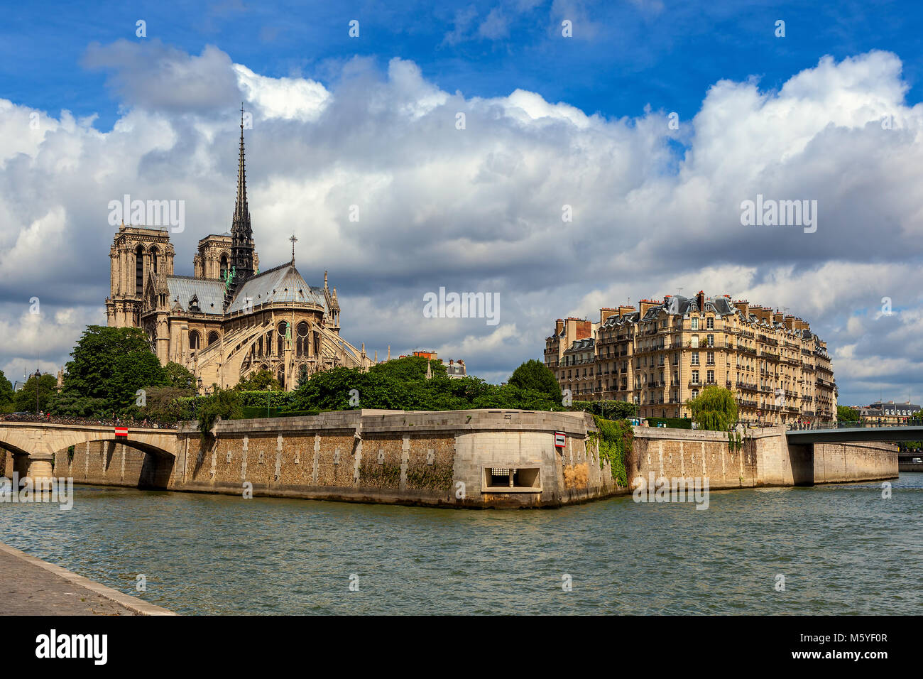 View of Seine river and famous Notre-Dame de Paris Cathedral under beautiful sky in Paris, France. - Stock Image
