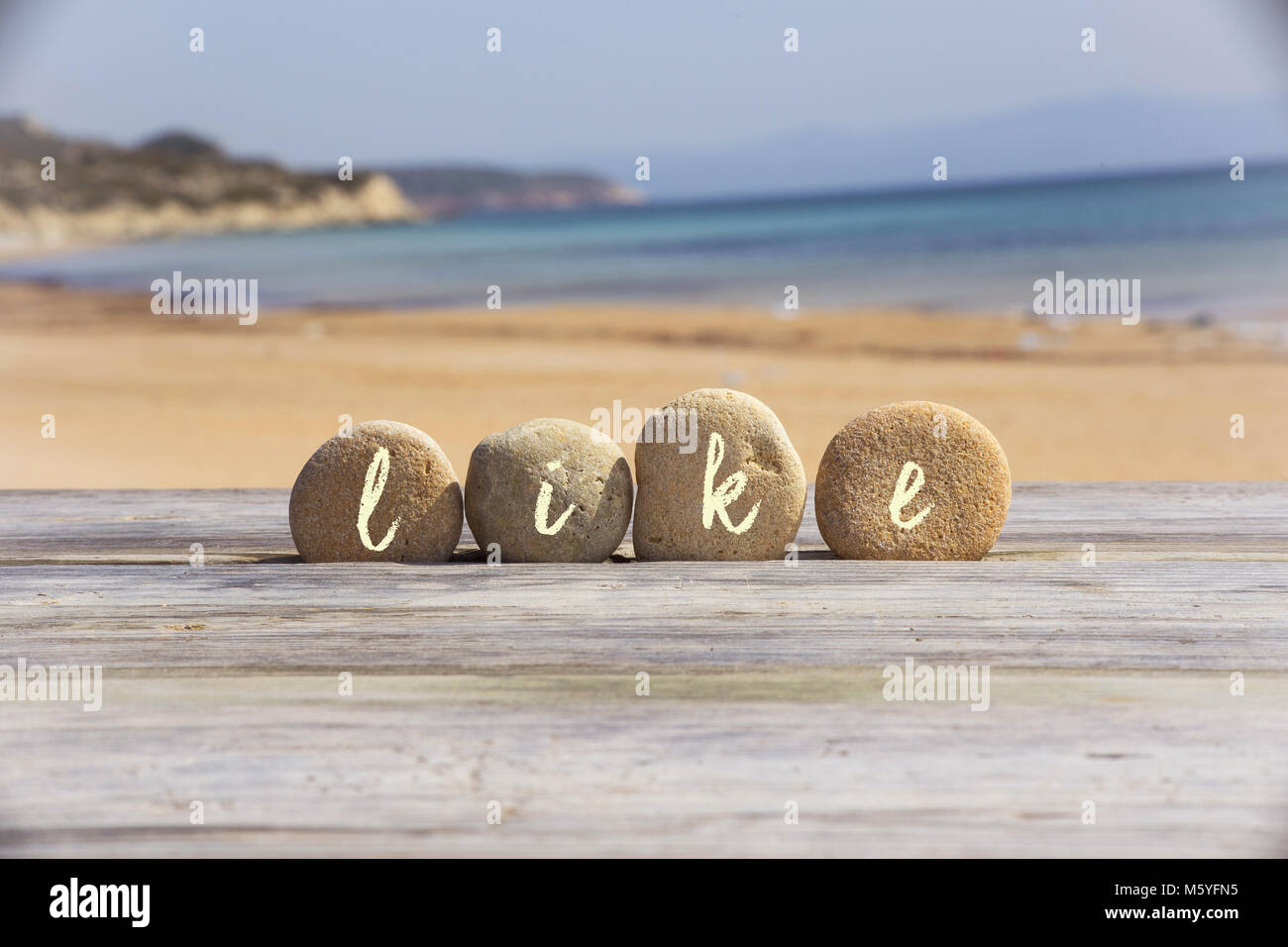 Sign like on top of sea rocks ,balancing by Pacific ocean - Stock Image