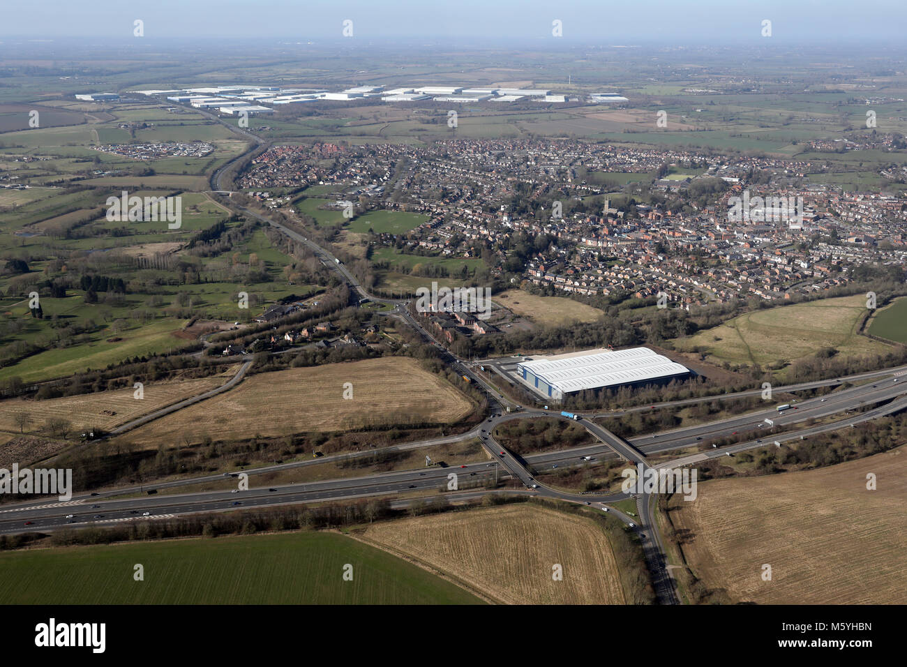 aerial view of Junction 20 of the M1 motorway at Lutterworth with Magna Park in background, Leicestershire, UK Stock Photo