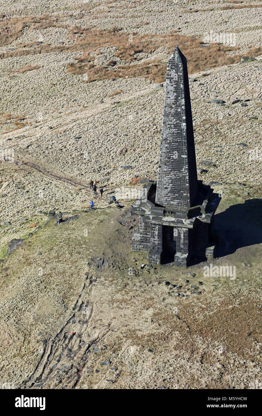 aerial view of walkers next to Stoodley Pike Monument, Todmorden, Lancashire, UK - Stock Image