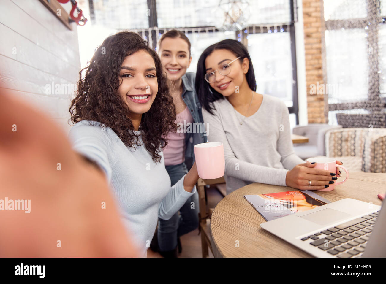 Attractive three students discarding from learning - Stock Image