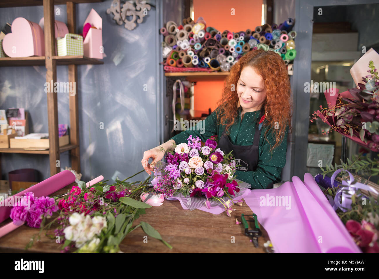 making up exquisite bouquet at flower shop Stock Photo