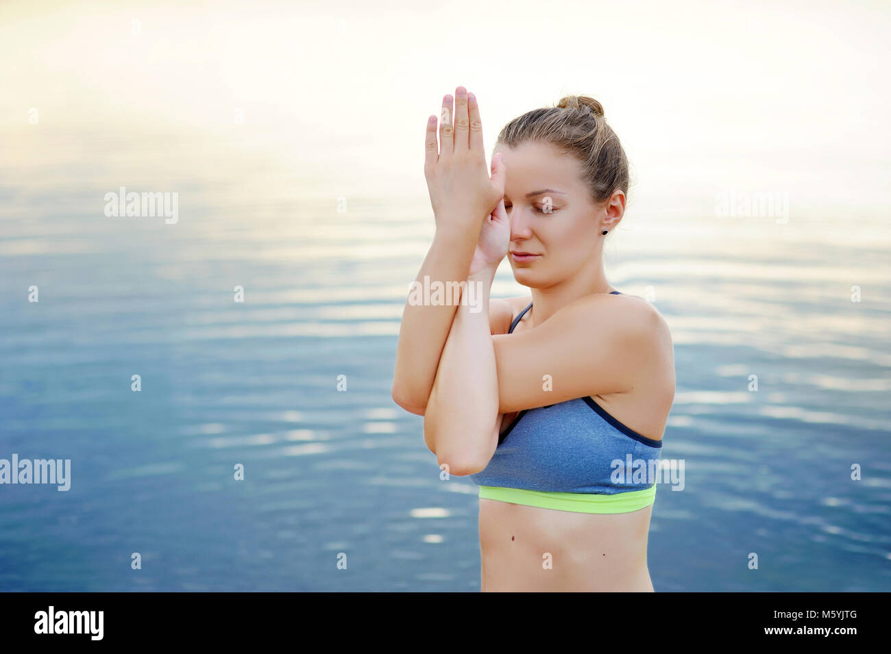 Closeup picture of hands in Eagle yoga  Pose position - Stock Image