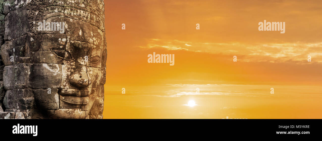 Bayon face over sunset, Angkor wat Cambodia, Unesco herritage - Stock Image