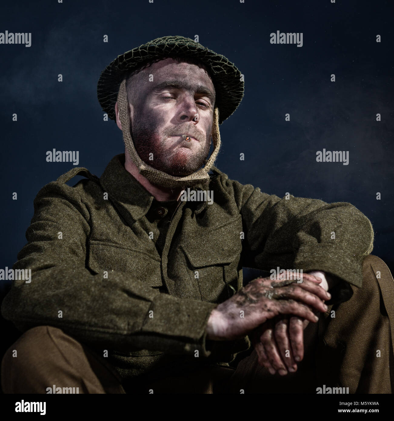 ww2 themed images of a soldier in authentic tunic set in the bleak winter snow - Stock Image